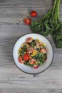 sorghum bowl with corn and tomatoes
